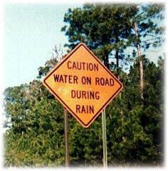 carretera-humor-senal-trafico mojada lluvia