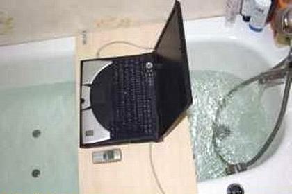 portatil ordenador banera bano ducha