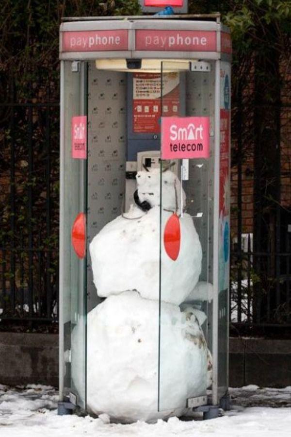 imagenes humor cabina telefono muneco nieve