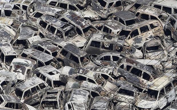 tsunami japon terremoto 2011 coches quemados puerto ibaraki tokai