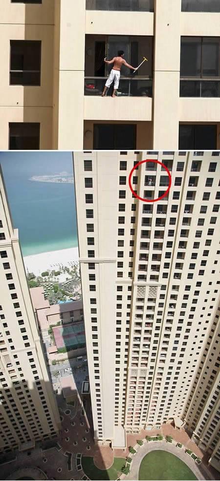 hombre limpiando ventanas altura trabajando riesgo