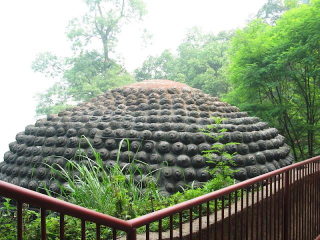 estatua gran buda leshan china monos bucles